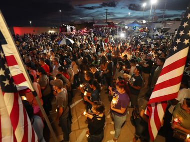 EL PASO, TEXAS - AUGUST 07: People attend a candlelight vigil at a makeshift memorial honoring victims of a mass shooting which left at least 22 people dead, on August 7, 2019 in El Paso, Texas. President Donald Trump visited the city earlier today. A 21-year-old white male suspect remains in custody in El Paso which sits along the U.S.-Mexico border.   (Photo by Mario Tama/Getty Images) ***BESTPIX***