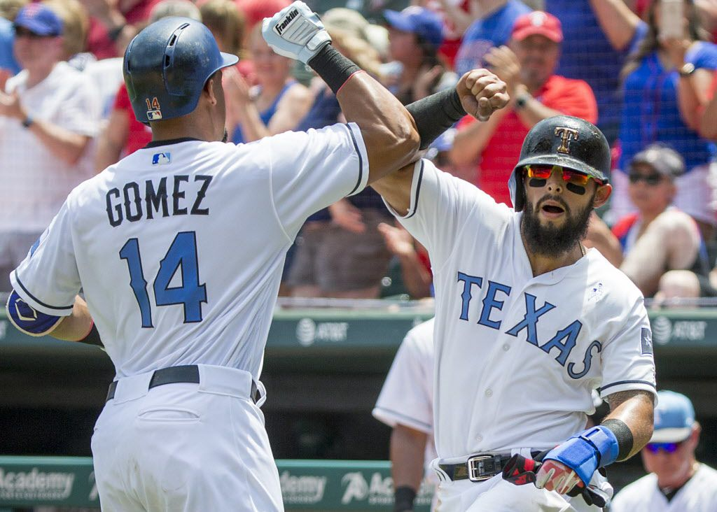 Texas Rangers center fielder Carlos Gomez celebrates with second baseman Rougned Odor driving in Odor with a two-run home run during the second inning against the Seattle Mariners after at Globe Life Park on Sunday, June 18, 2017, in Arlington. (Smiley N. Pool/The Dallas Morning News)