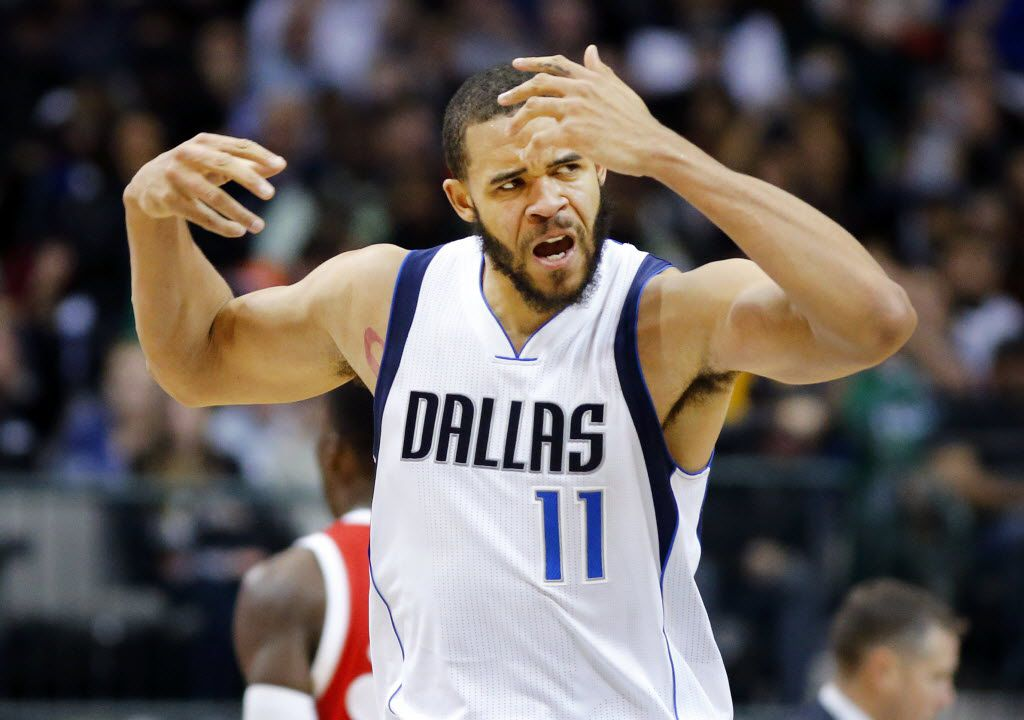 Dallas Mavericks center JaVale McGee (11) gets the crowd in the game after his second half dunk against Memphis Grizzlies forward Zach Randolph (50) at the American Airlines Center in Dallas, Friday, December 18, 2015. The Mavs won 97-88. (Tom Fox/The Dallas Morning News)