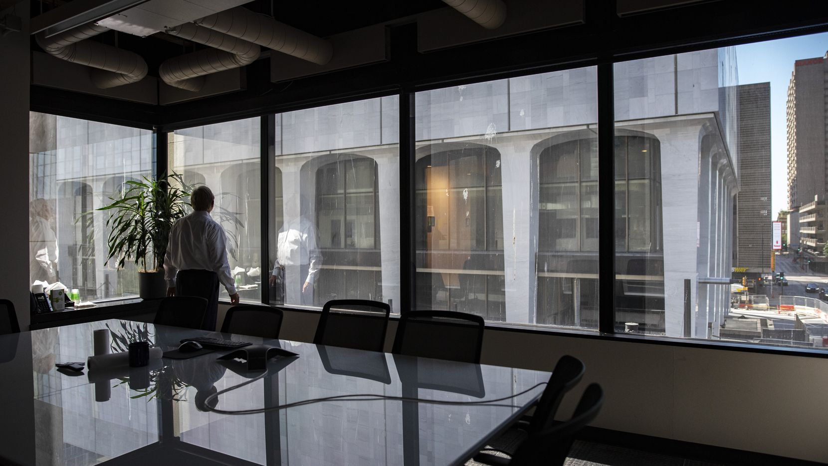 Jerry Merriman, president and founder of Merriman Anderson Architects, looks at The National building from a conference room inside his offices in downtown Dallas on Aug. 12.