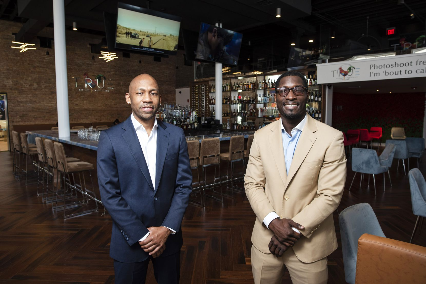 Owner Kevin Kelley (left) and general manager Rico Spears at True Kitchen + Kocktails restaurant in downtown Dallas.