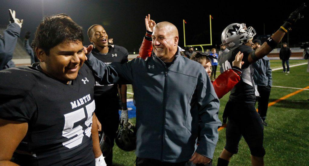 Martin head coach Bob Wager (center) congratulates his offensive lineman Carlos Rodriguez (55) after their win over Bowie at Maverick Stadium in Arlington, Texas, Thursday, November 7, 2019. Martin won the district title, 44-19. (Tom Fox/The Dallas Morning News)