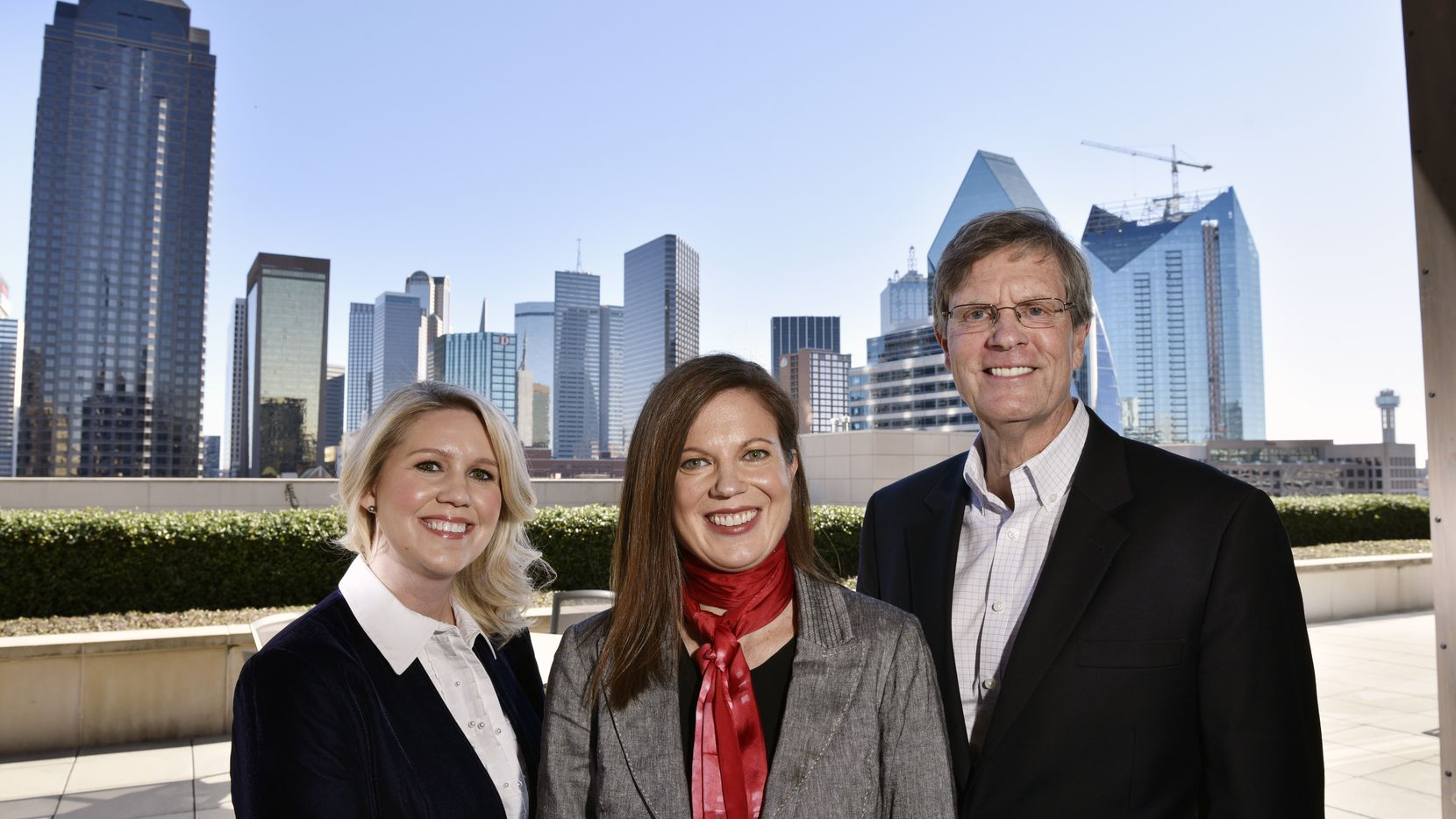 Kelly Rentzel, center, general counsel for Texas Capital Bank, with a member of her informal support network, Shannon Wherry, director of communications for Texas Capital Bank, and Kelly's father, Chris Rentzel, at the bank's Uptown offices.
