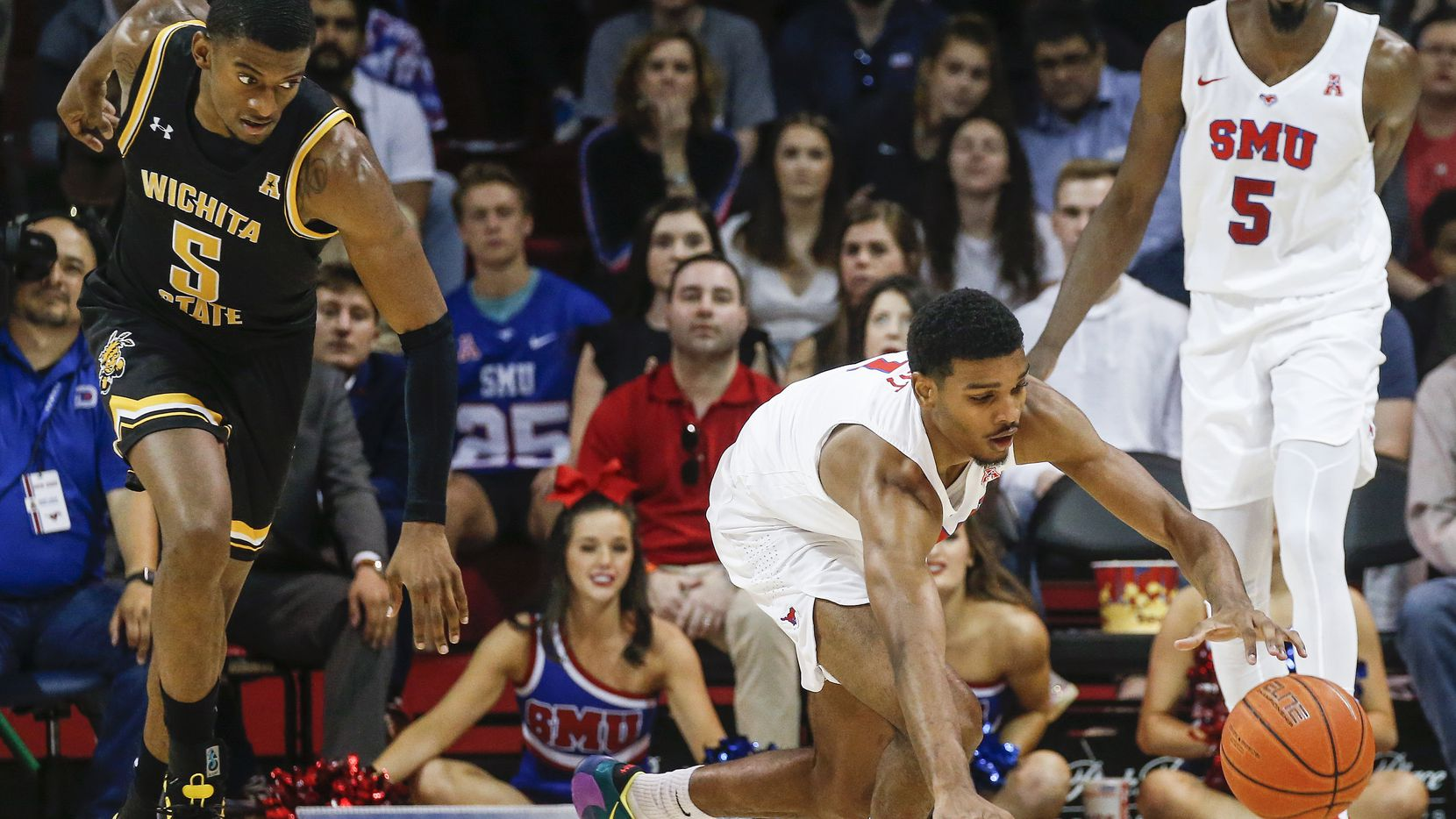 Southern Methodist Mustangs forward Feron Hunt (1) reaches to recover a loose ball past Wichita State Shockers forward Trey Wade (5) during the first half of am NCAA men's basketball matchup between SMU and Wichita State on Sunday, March 1, 2020 at Moody Coliseum in University Park, Texas.