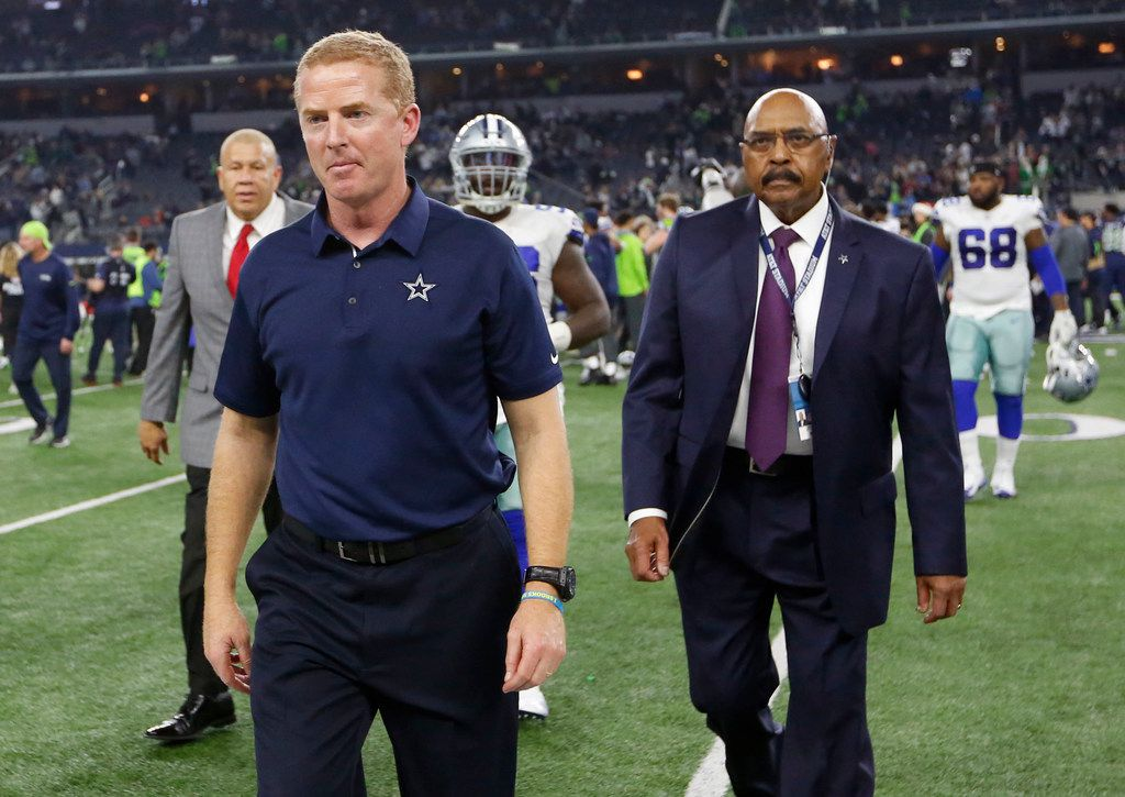 Dallas Cowboys head coach Jason Garrett exits the field after losing to the Seattle Seahawks 21-12 at AT&T Stadium in Arlington, Texas on Sunday, December 24, 2017. (Vernon Bryant/The Dallas Morning News)