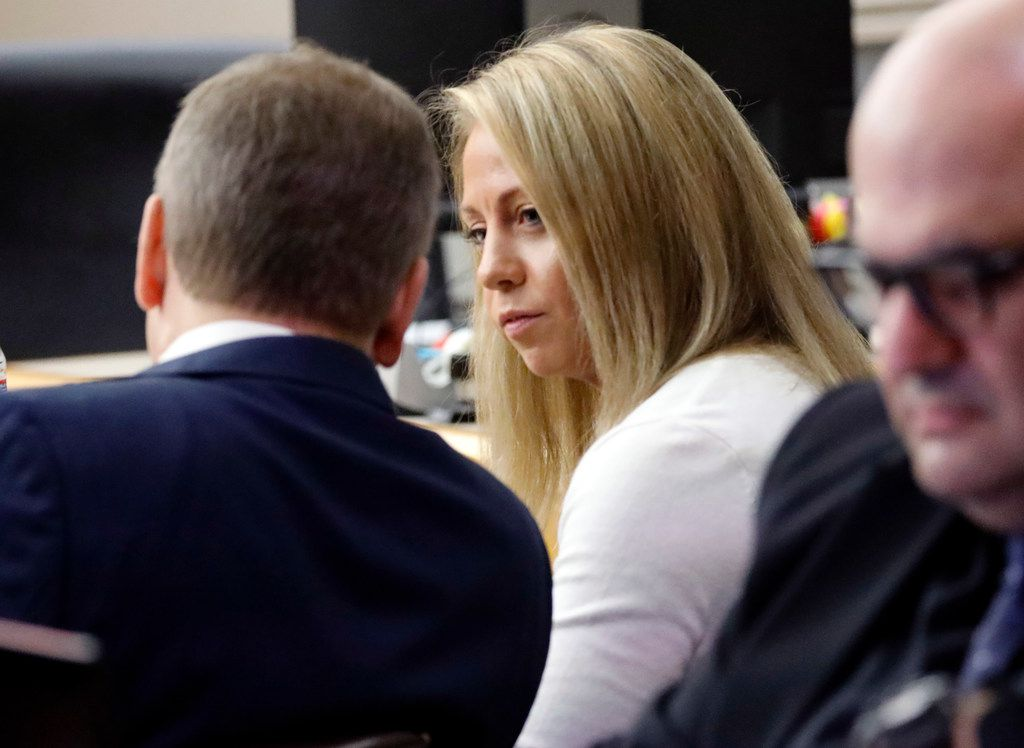 Fired Dallas police Officer Amber Guyger talks to defense attorney Toby Shook before proceedings in her murder trial begin Tuesday.