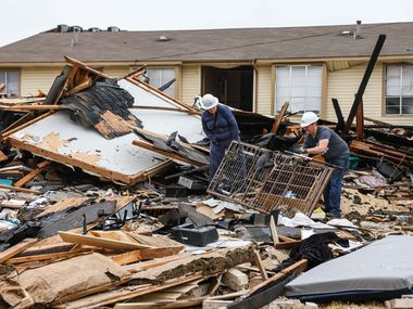 Dallas Fire-Rescue workers continue to investigate and remove debris from an apartment complex in southeast Oak Cliff on Thursday, Sept. 30, 2021.