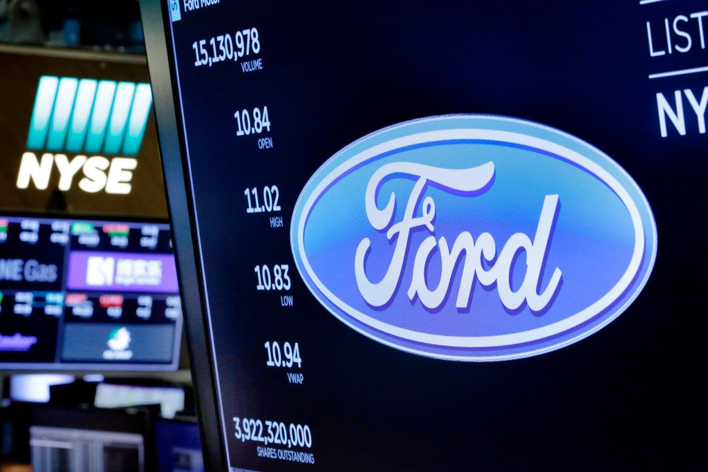 The logo for Ford appears above a trading post on the floor of the New York Stock Exchange on Monday.