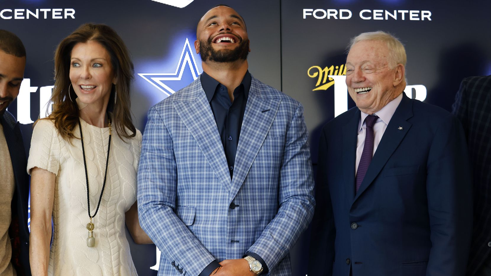 Dallas Cowboys quarterback Dak Prescott (center) laughs with owner Jerry Jones and Executive Vice President and Chief Brand Officer Charlotte Jones Anderson share a laugh as they posed for photos following a press conference at The Star in Frisco, Texas, Wednesday, March 10, 2021. Dak spoke about his freshly signed 4-year, $160 million contract with the team.