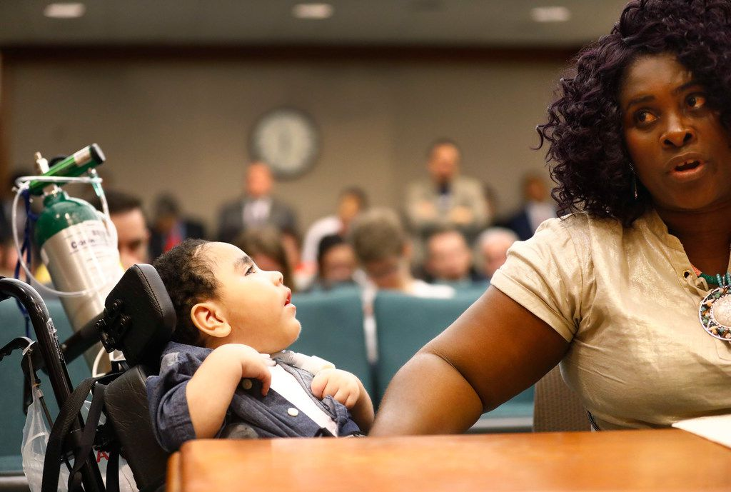 Alongside her medically fragile 3 yr-old son D'ashon Morris, Linda Badawo of Mesquite, Texas testifies before members of the Texas House Committee on Human Services, Wednesday, June 20, 2018 after a recent Dallas Morning News story regarding Medicaid managed care and the Health and Human Services Commission. Both were featured in the story.