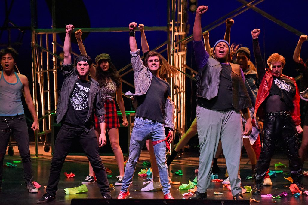Johnny, played by Griffin Shoemaker (third from left), and Tunny, played by Darnell Robinson (second from right), lead a group of dancers during a dress rehearsal for Green Day's American Idiot, directed by Valerie Hauss-Smith, at the Moody Performance Hall in Dallas on Dec. 30, 2018.