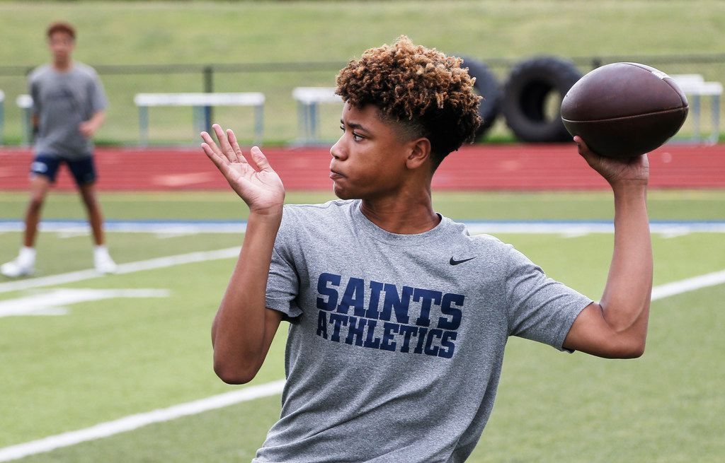 Fort Worth All Saints freshman quarterback TJ Williams looks to throw a pass during a 7 on 7 football practice at Fort Worth All Saints, Tuesday, June 19, 2018. (Brandon Wade/Special Contributor)