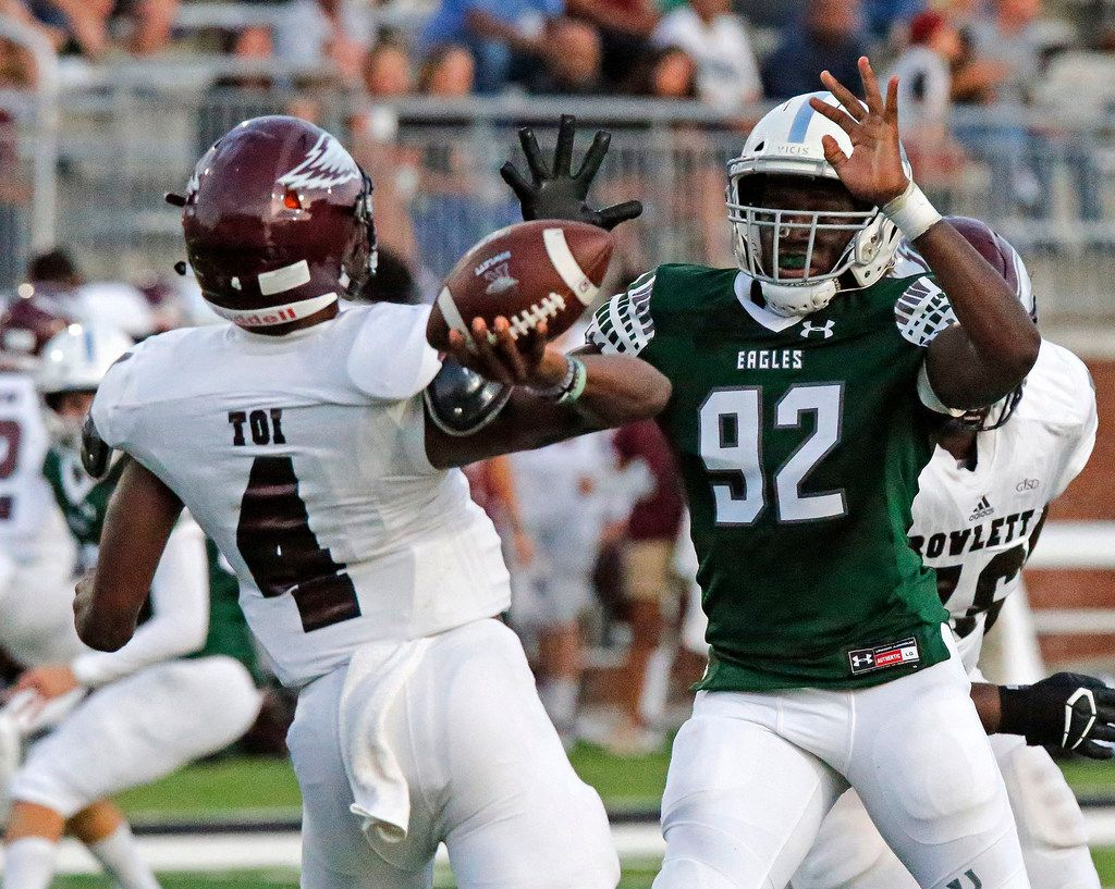 Rowlett High School quarterback Alex Routt (4) is hurried by Prosper High School defensive end Malachi Edwards (92) during the first half as Prosper High School hosted Rowlett High School in a non-district football game at Children's Health Stadium in Prosper on Friday, August 30, 2019. (Stewart F. House/Special Contributor)