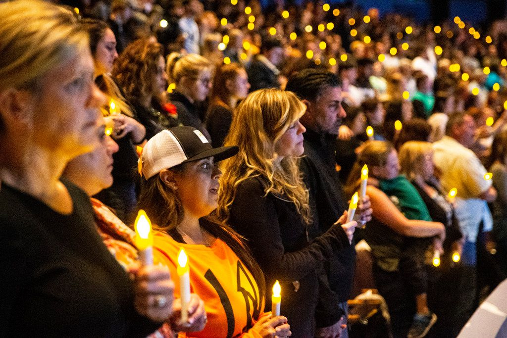 People gather for a candlelight vigil to honor the victims of a mass shooting in Thousand Oaks, Calif.