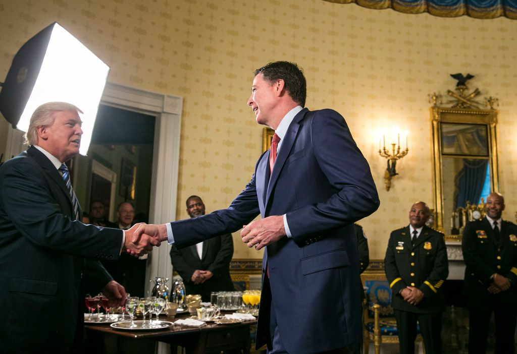 President Donald Trump shook hands with James Comey, the FBI director, at the White House on Jan. 22, 2017.