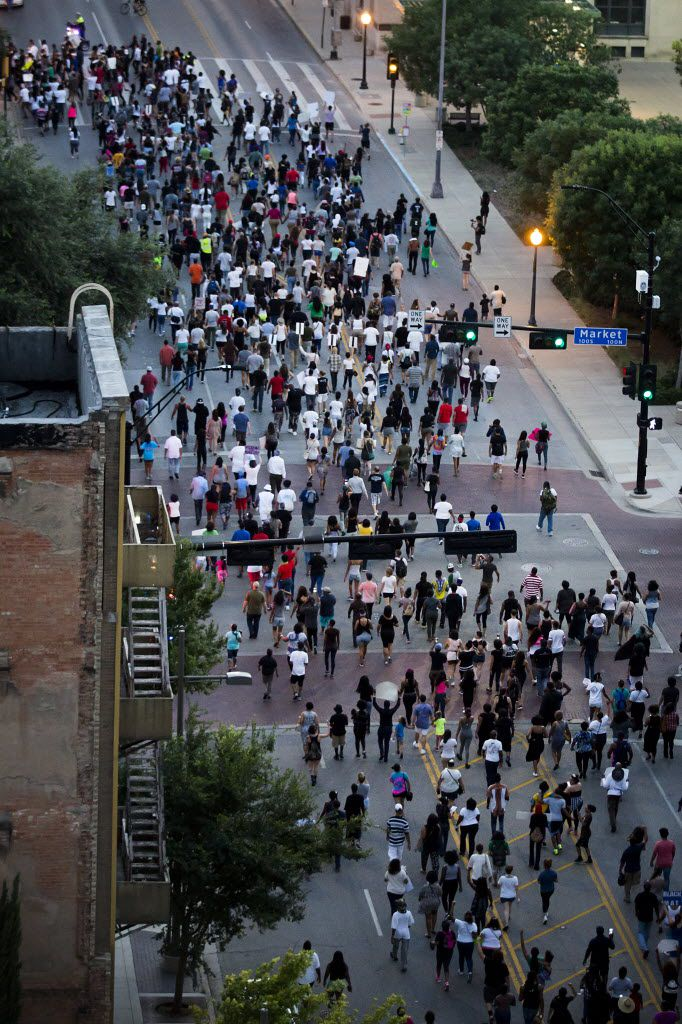 Even people who weren't at last year's protest march but have loved ones who were there could be at risk of heightened stress around Friday's anniversary of the deadly ambush shootings. (File Photo/Smiley N. Pool)