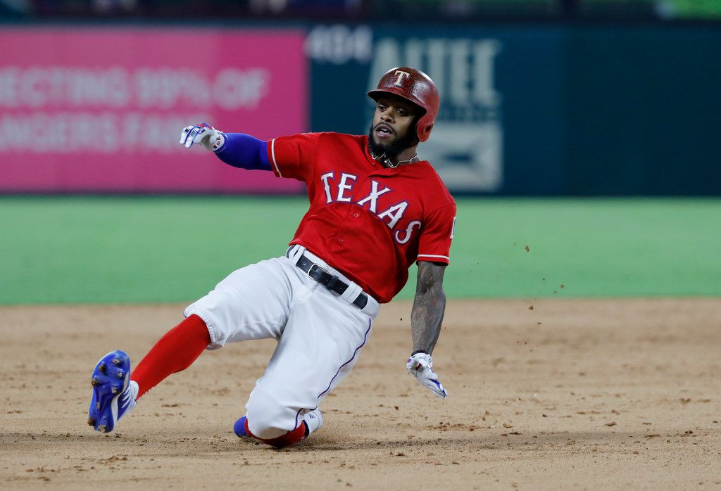 Texas Rangers' Delino DeShields slides into third with a triple on a pitch from Minnesota Twins' Devin Smeltzer in the ninth inning of a baseball game in Arlington, Texas, Thursday, Aug. 15, 2019. (AP Photo/Tony Gutierrez)