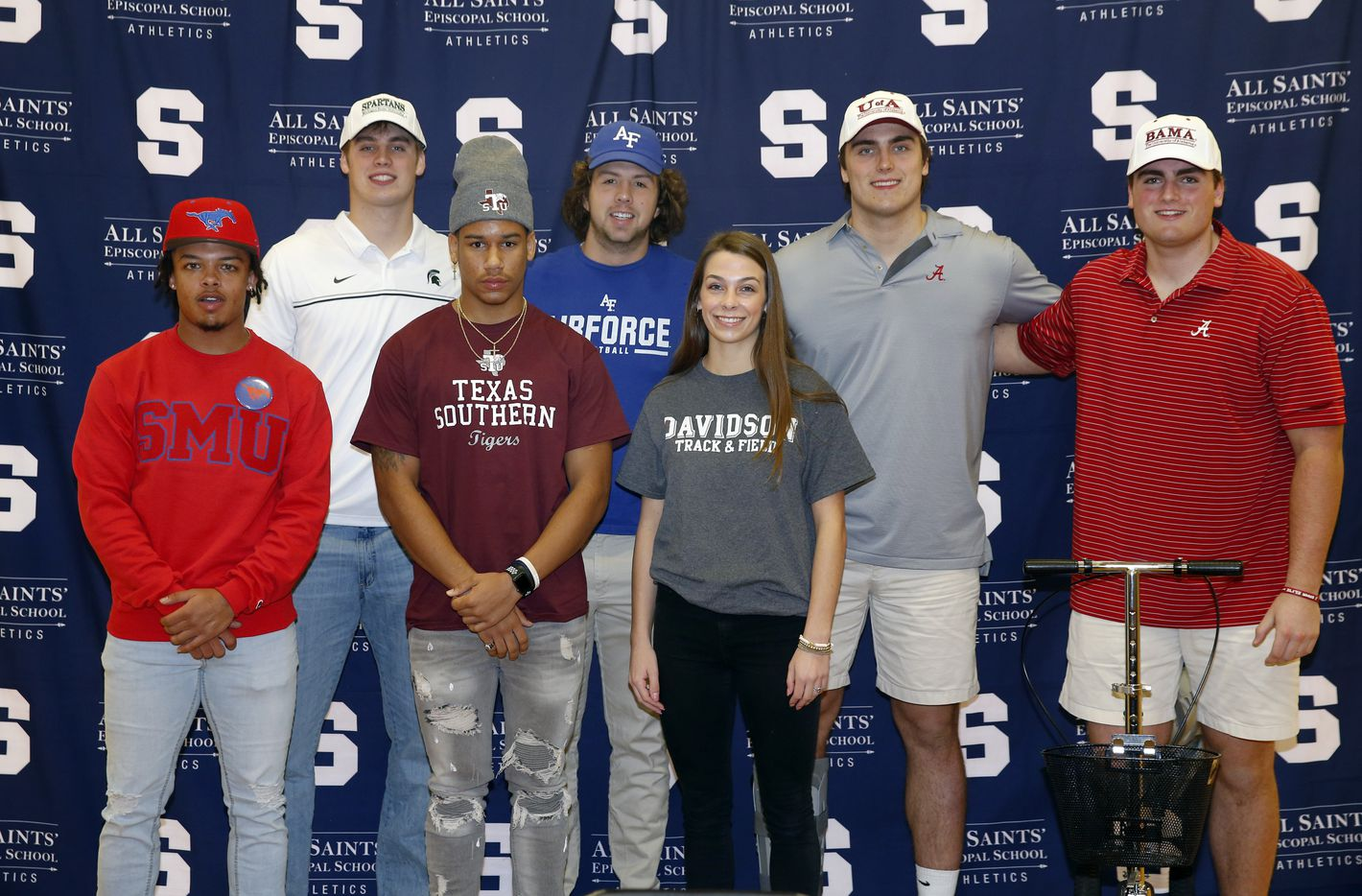 Fort Worth All Saints' Episcopal School athletes signed their national letters in the schools gymnasium, Wednesday, December 16, 2020. They are from left, Montaye Dawson (SMU), Hampton Fay (Michigan State), Nick Cole (Texas Southern), Paul Breedlove (Air Force), Hannah Fay (Davidson track and field), Tommy Brockermeyer and his twin brother James Brockermeyer (Alabama). (Tom Fox/The Dallas Morning News)