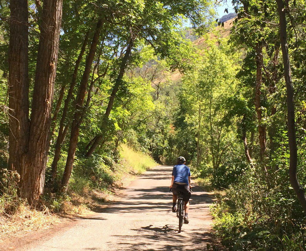 A biker glides along a flat section of City Creek Canyon Trail, which starts in downtown Salt Lake City.