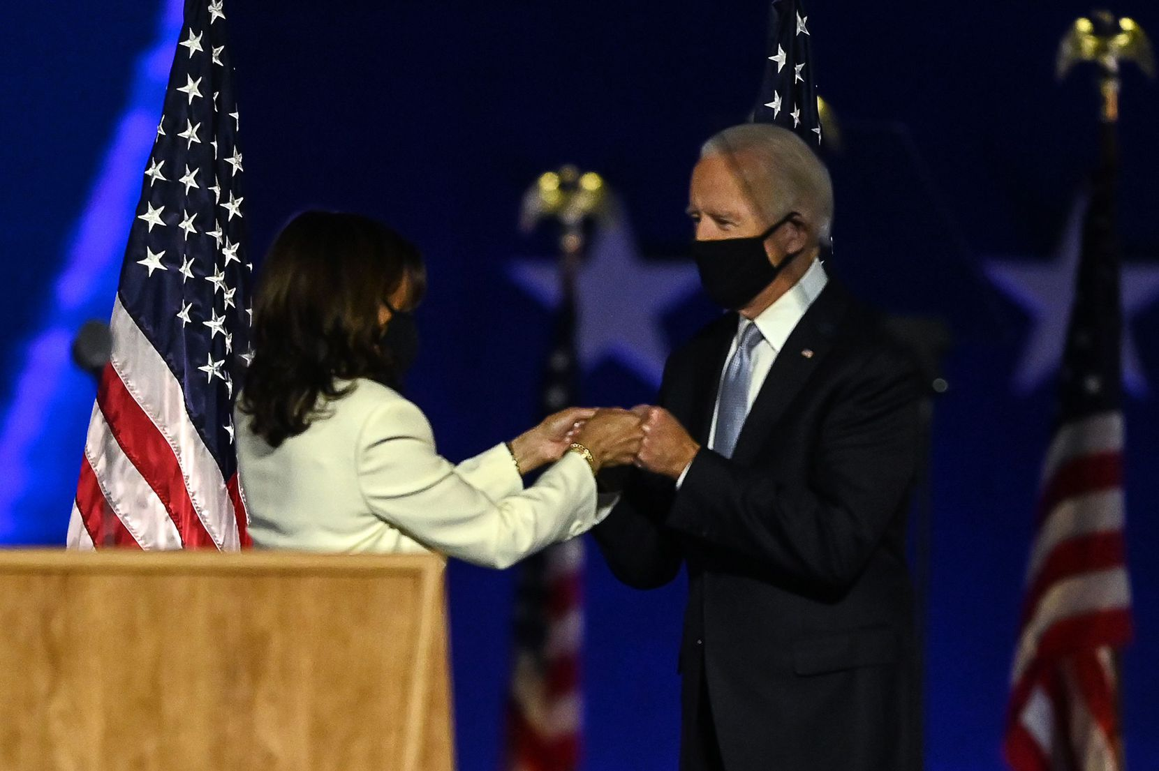 US President-elect Joe Biden and Vice President-elect Kamala Harris bump fists as they arrive to deliver remarks in Wilmington, Delaware, on November 7, 2020, after being declared the winners of the presidential election. (Photo by Jim WATSON / AFP) (Photo by JIM WATSON/AFP via Getty Images)