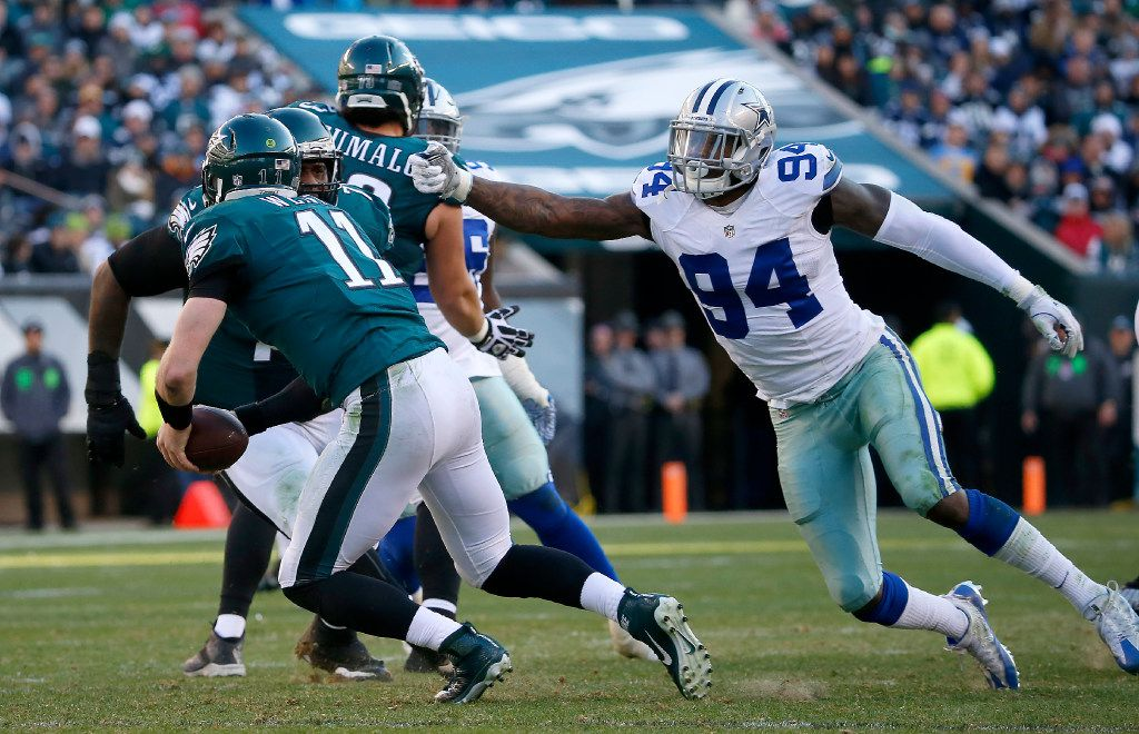 Dallas Cowboys defensive end Randy Gregory (94) chases Philadelphia Eagles quarterback Carson Wentz (11) during the third quarter at Lincoln Financial Field in Philadelphia, Sunday, Jan. 1, 2017. The Dallas Cowboys lost 27-13.