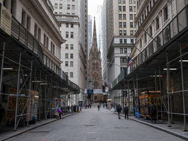 This photo from March 16 shows sparse pedestrian traffic along Wall Street in Lower Manhattan. Investors should pay attention to the SPIVA report, Standard and Poor's regular examination of how managed funds have done relative to the index they aim to beat, Scott Burns says. It comes out twice a year.