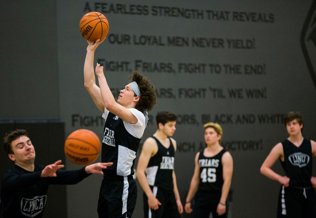 Bishop Lynch High School varsity basketball player Jarett Nunez, second from left, takes a shot during practice on Thursday, January 24, 2019 at Bishop Lynch High School in Dallas. Nunez was born with a deformed left hand, but that didn't stop him from making the varsity basketball team, running track or playing football. (Ashley Landis/The Dallas Morning News)