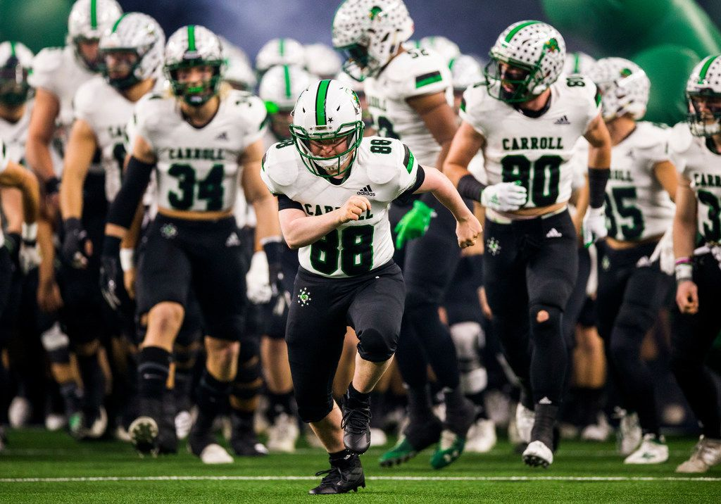 Southlake Carroll football players run out on the field before a Class 6A Division I area-round high school football playoff game between Southlake Carroll and DeSoto on Friday, November 22, 2019 at AT&T Stadium in Arlington. (Ashley Landis/The Dallas Morning News)