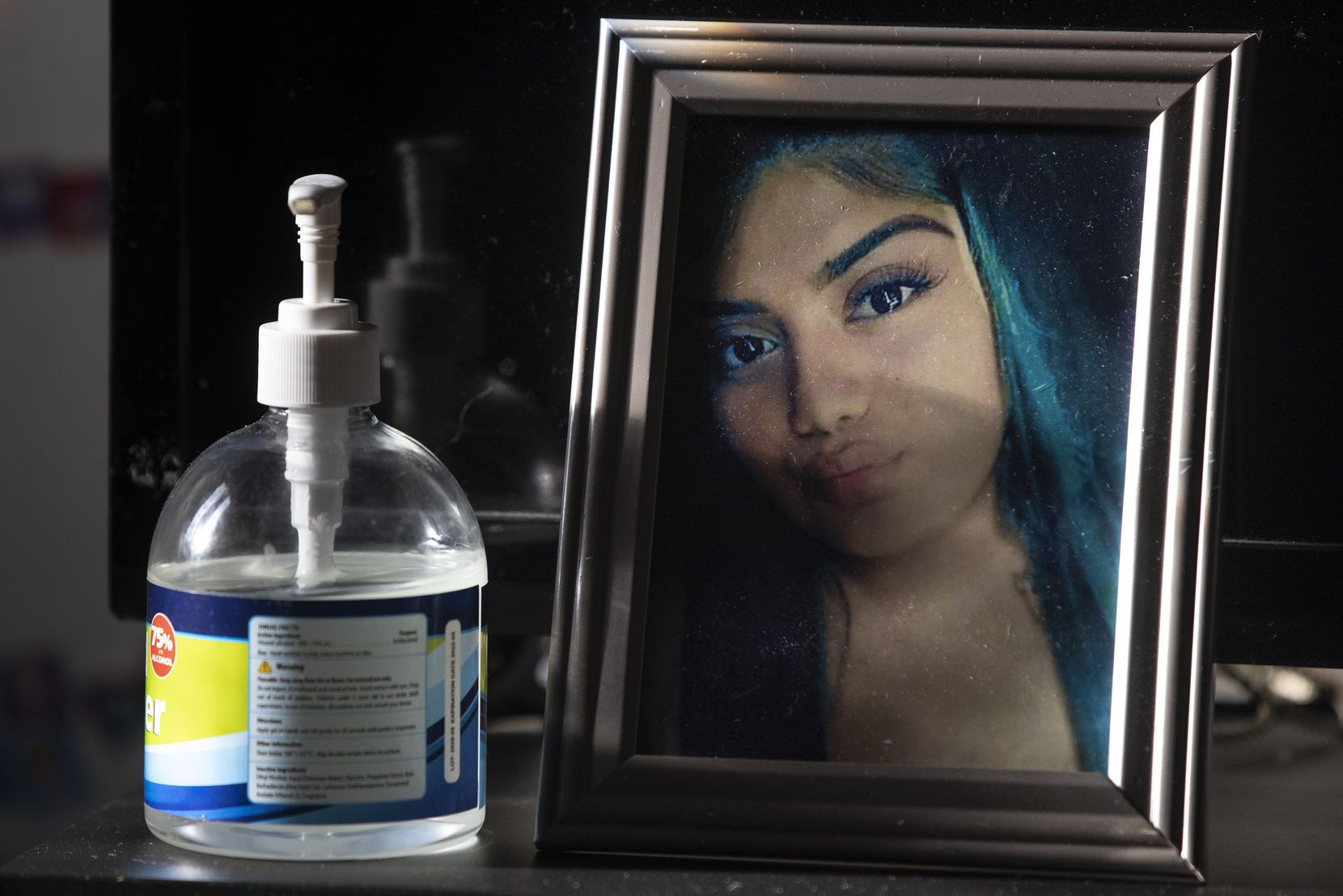 """A photo of the late Nely Palacios, 22, is displayed at the Palacios' home. Nely's sister, Lucy, says she seldom leaves home because of her fears about COVID-19. """"I've seen what it did to my sister and my father."""""""