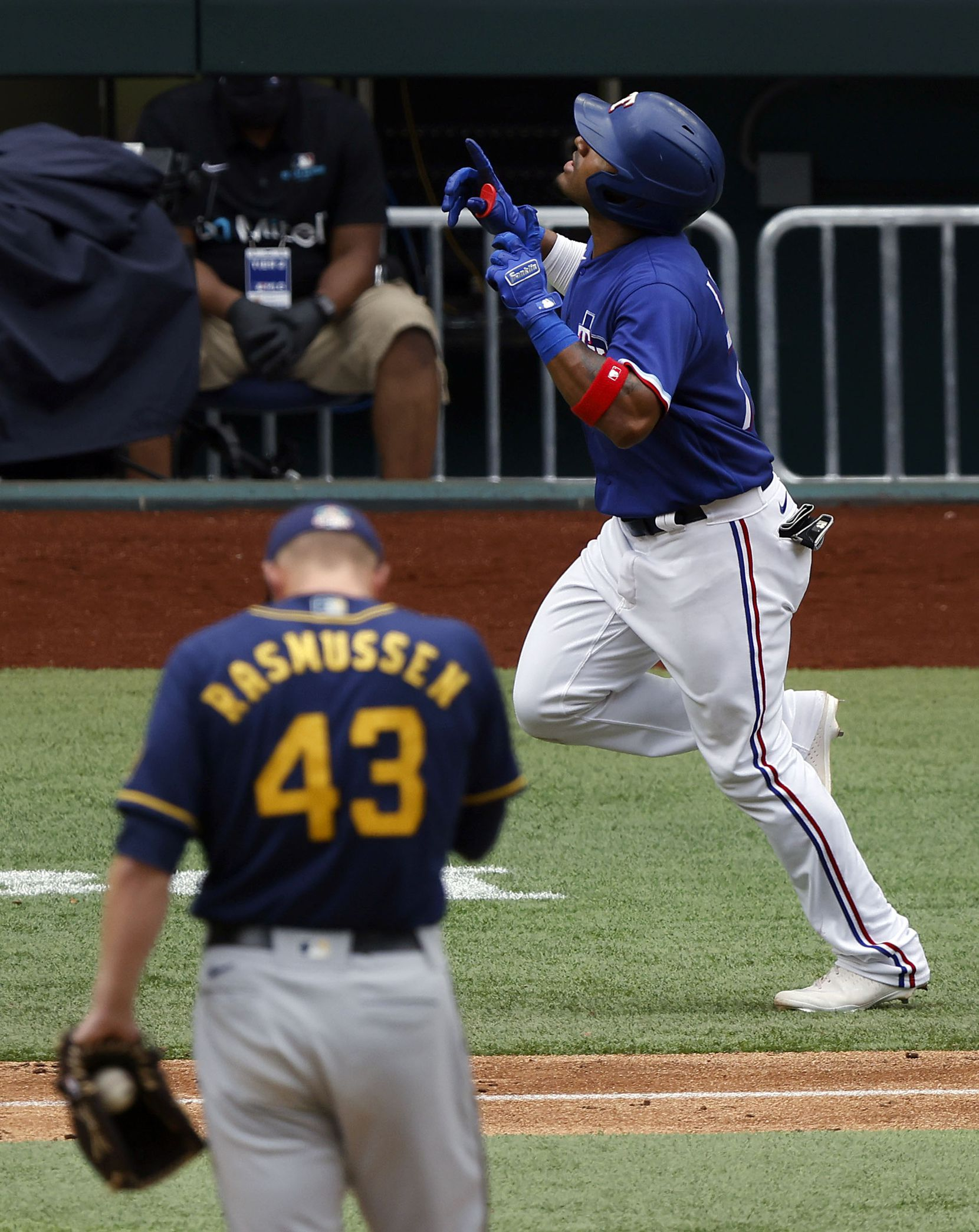 Texas Rangers batter Andy Ibáñez looks skyward after hitting a solo home run in the eighth inning off of Milwaukee Brewers relief pitcher Drew Rasmussen (43) at Globe Life Field in Arlington, Texas. The teams were playing in an exhibition game, Tuesday, March 30, 2021. (Tom Fox/The Dallas Morning News)
