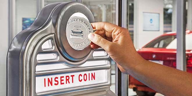 """Carvana customers get a giant """"coin"""" to deliver the car they ordered."""