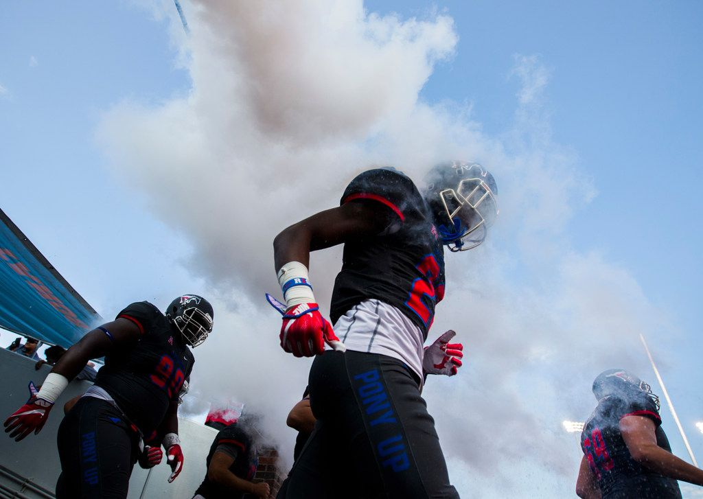 Southern Methodist Mustangs players enter the field before a game between Arkansas State and SMU on Saturday, September 23, 2017 at Ford Stadium on the SMU campus in Dallas. (Ashley Landis/The Dallas Morning News)