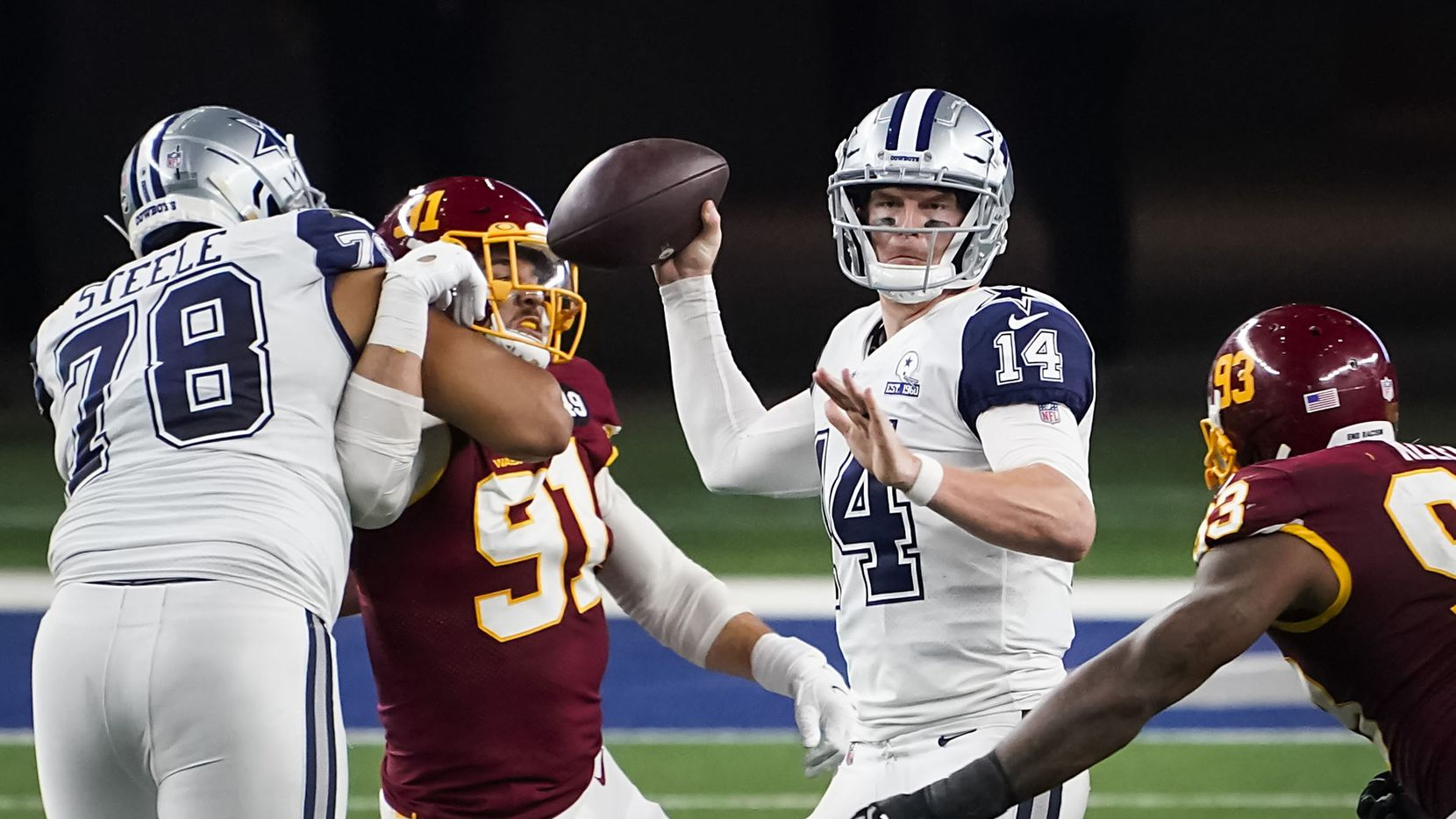 Dallas Cowboys quarterback Andy Dalton (14) looks to pass as offensive tackle Terence Steele (78) works against Washington Football Team defensive end Ryan Kerrigan (91) during the fourth quarter of an NFL football game at AT&T Stadium on Thursday, Nov. 26, 2020, in Arlington.