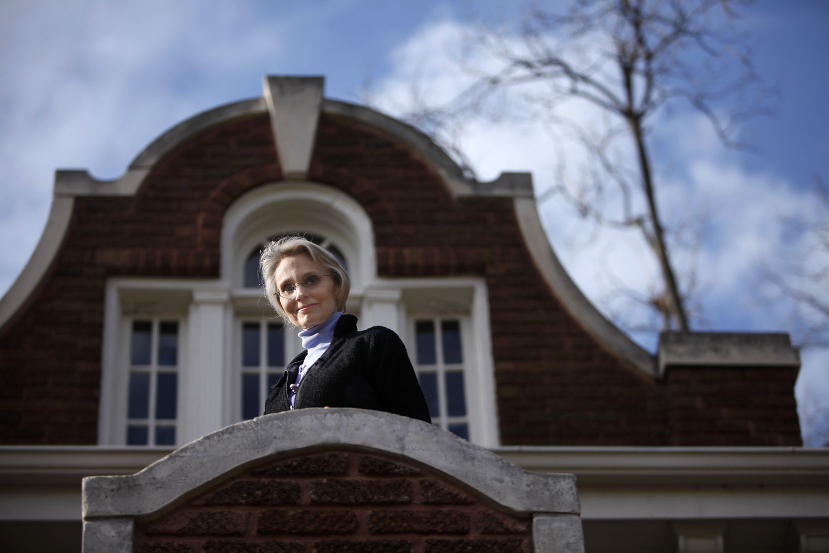 Virginia McAlester is widely credited as being a founding member of Preservation Dallas in the early 1970s, which led a successful effort to protect Swiss Avenue from redevelopment. She is shown here on the balcony of her Swiss Avenue home in 2011.