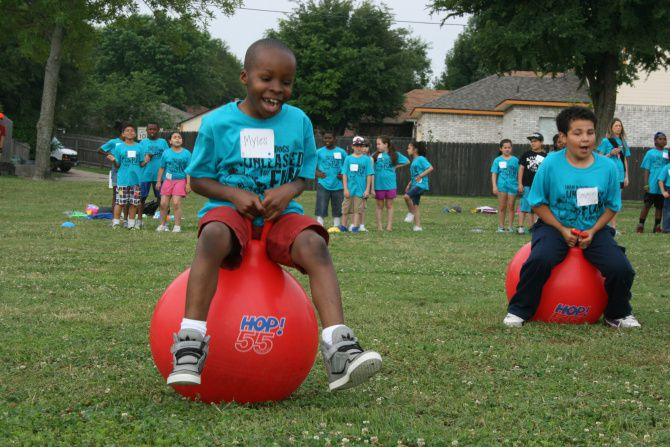Myles Harris, a third grader at Mesquite's Shaw Elementary School bounces along on a space hopper during the school's play day in 2019. This year, PE teachers are conducting a virtual play day after the coronavirus pandemic required school buildings to close down.
