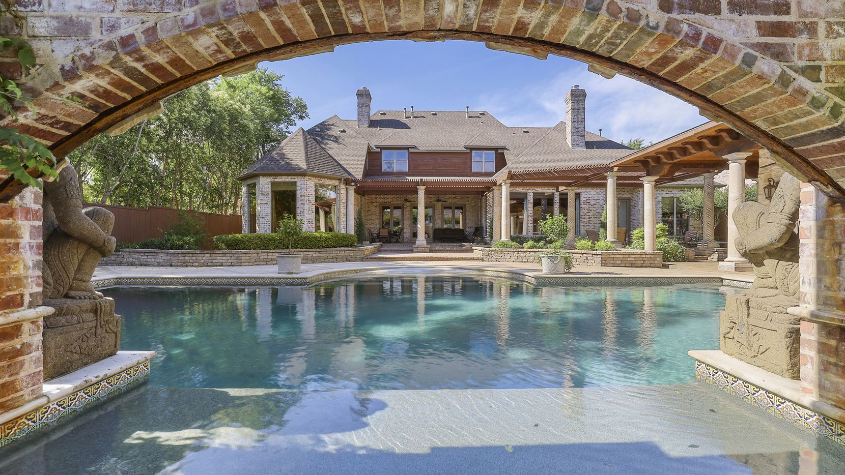 The five-bedroom home at 5964 Azalea Lane in Preston Hollow has a pool, covered patio and detached hot tub.