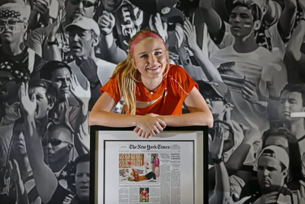 Haley Berg poses for a photograph with the framed cover of The New York Times featuring her in a front-page story at Performance Indoor Training in Frisco, Texas, Friday, March 18, 2016. (Jae S. Lee/The Dallas Morning News)
