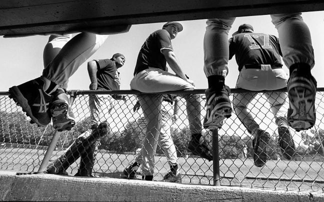The Dallas Sox gather around their dugout, awaiting the start of their game. Staff photograph taken July 23, 1995.