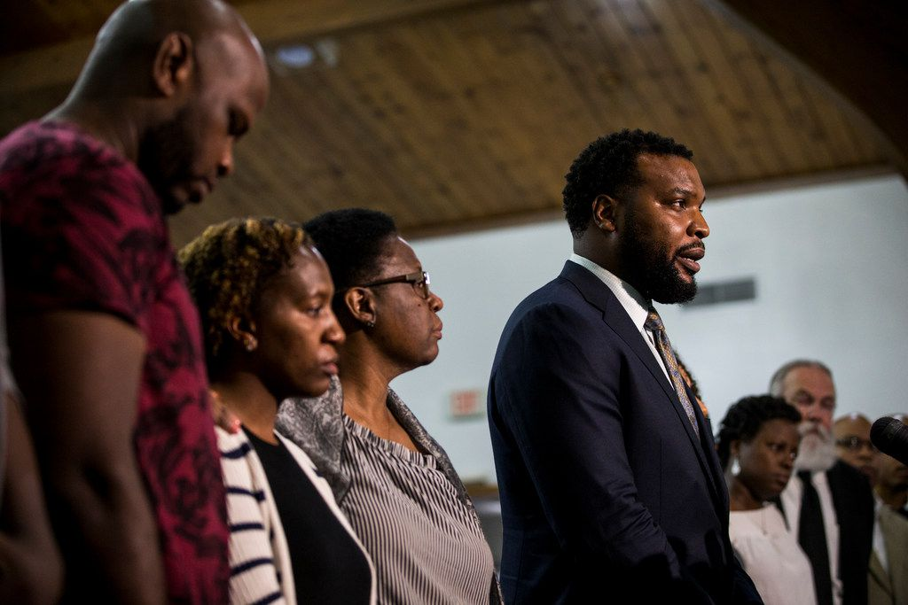 Jean's family lawyer Lee Merritt gives talks to members of the press following a prayer vigil for Botham Shem Jean at the Dallas West Church of Christ on Saturday, Sept. 8, in Dallas. He was shot by a Dallas police officer in his apartment on Thursday night.