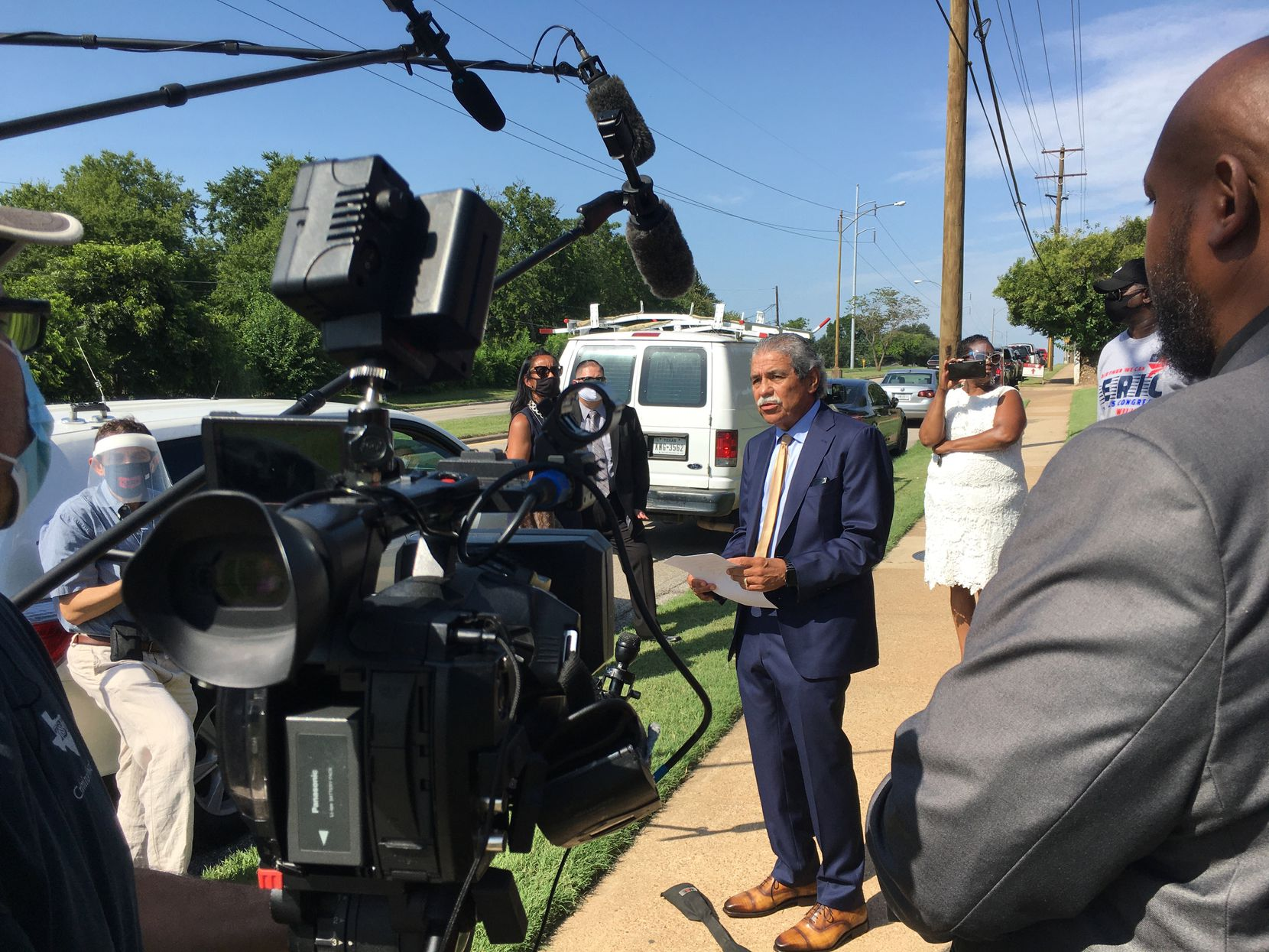 Dallas ISD Superintendent Michael Hinojosa addressed reporters July 14 while DISD trustee Maxie Johnson (right) looked on. DISD leaders opposed the placement of a charter school on the campus of Paul Quinn College in southern Dallas.