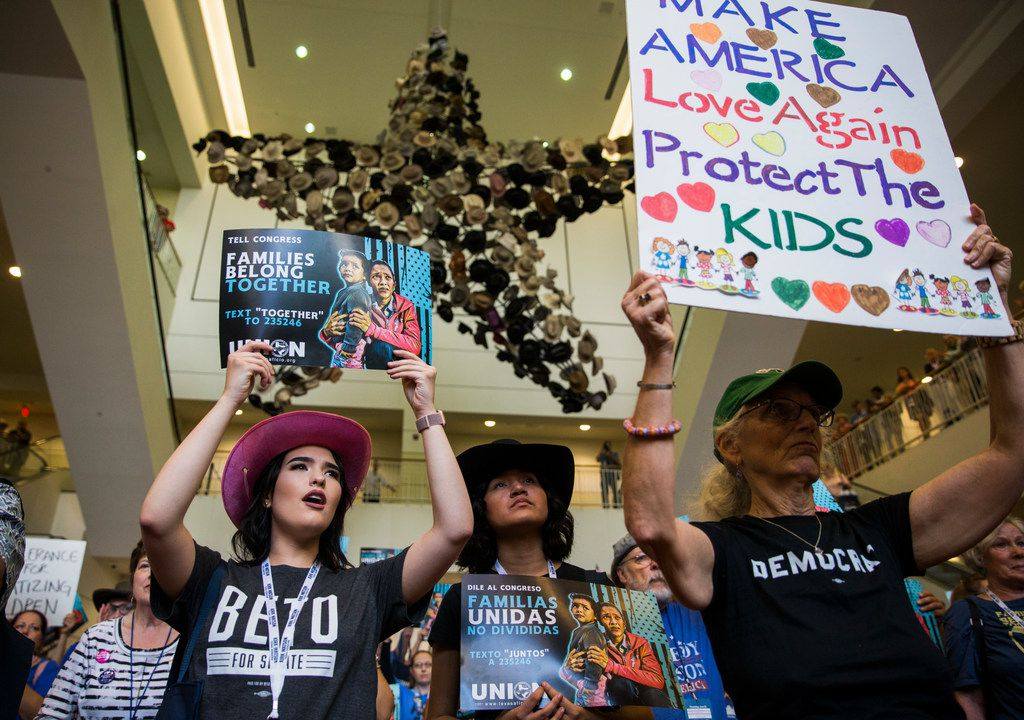 Molly Chambers, left, Ashly Ibarra, center, and Cathy Clark chant and hold signs  during a Families First Rally at the Texas Democratic Convention on Saturday, June 23, 2018 at the Fort Worth Convention Center in Fort Worth.