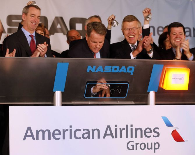 Doug Parker, CEO of the new American Airlines, signs the Nasdaq board as the opening bell rang for the company's listing on the exchange.
