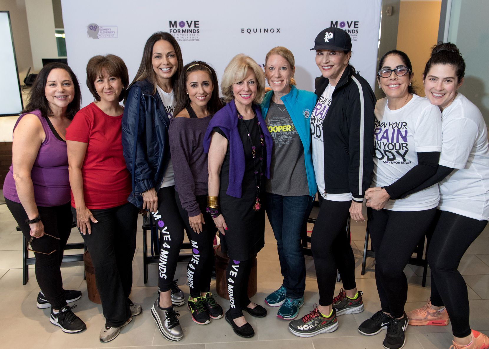 Amy Weinreb (from left), Anna de Haro, Moll Anderson, Sonia Azad, Dr. Sandra Chapman, Katherine Nashatker, JanMiller Rich, Sue Gragg and Nena Oshman attended the Move for Minds event in June.