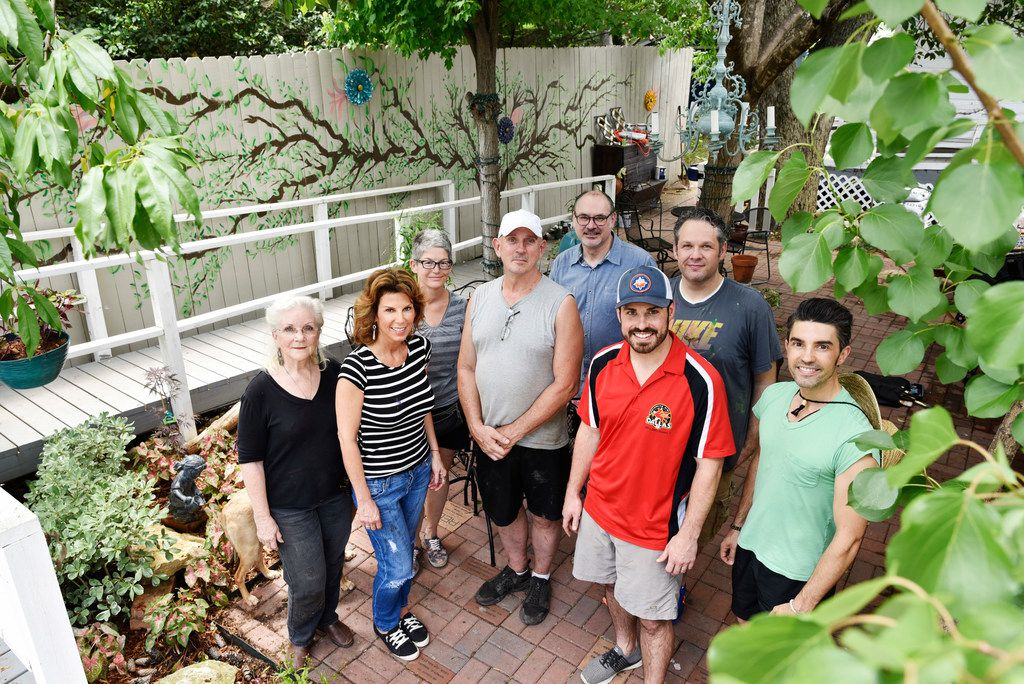 Van Johnson (center, wearing white cap), organizer for the Oak Cliff Gardeners Facebook forum, met up with several of the group's members to renovate the backyard of a local home for patients with advanced AIDS in Oak Cliff on May 26.