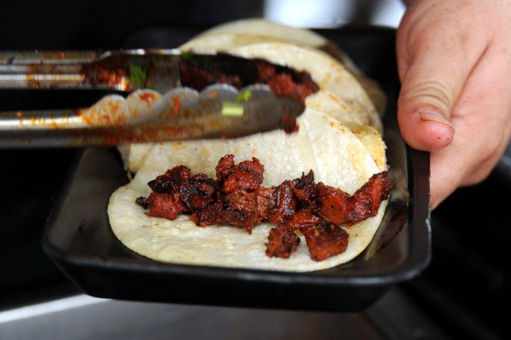 La Huasteca serves pork street tacos at Taste of Dallas in Fair Park on June 14, 2015.