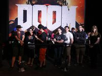 Gamers line up for a free six minute game time with the new Doom game in the exhibit hall at QuakeCon 2015 on Saturday July 25, 2015 at the Hilton Anatole in Dallas. Many players got in line several times to play the trial.