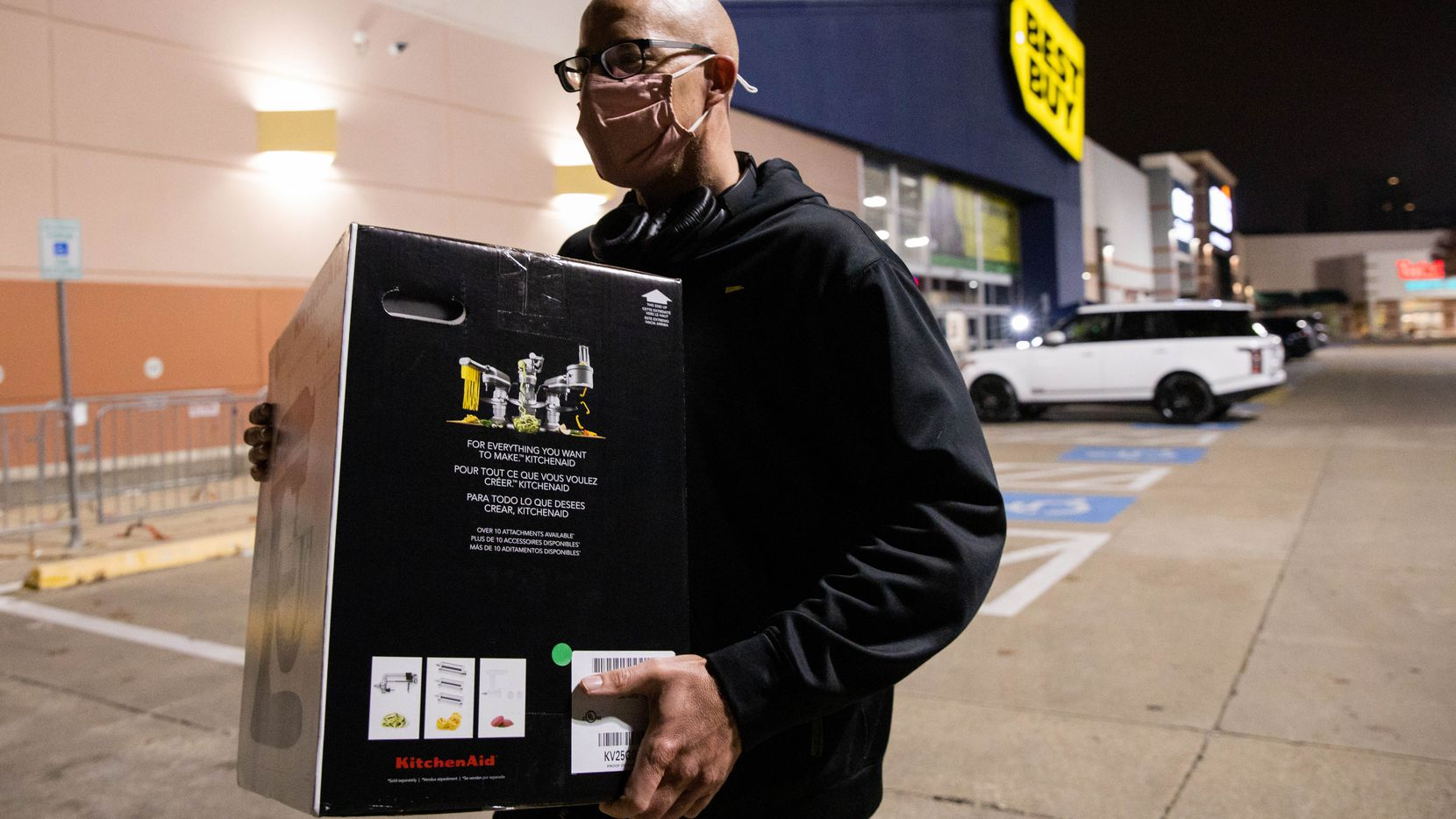 Sean Berube, who was visiting from Arizona, walked out of Best Buy with a KitchenAid mixer on Black Friday last year in Dallas.