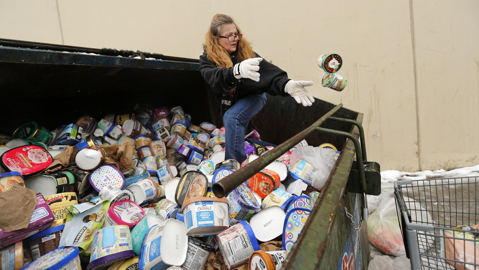 """After seeing a posting on Facebook, LaDonna (no last name given) drove from Johnson County to collect some of the ice cream thrown into dumpsters at a Southwest Arlington Kroger store on Wednesday. LaDonna said she's collecting the frozen goods for her neighbors. """"I do it because they would do it for me,"""" she said. The power was back Wednesday and the store was open again."""