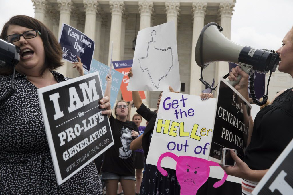 Pro-abortion rights and anti-abortion protesters rally in front of the U.S. Supreme Court in Washington as the justices hear arguments over Texas' abortion law.
