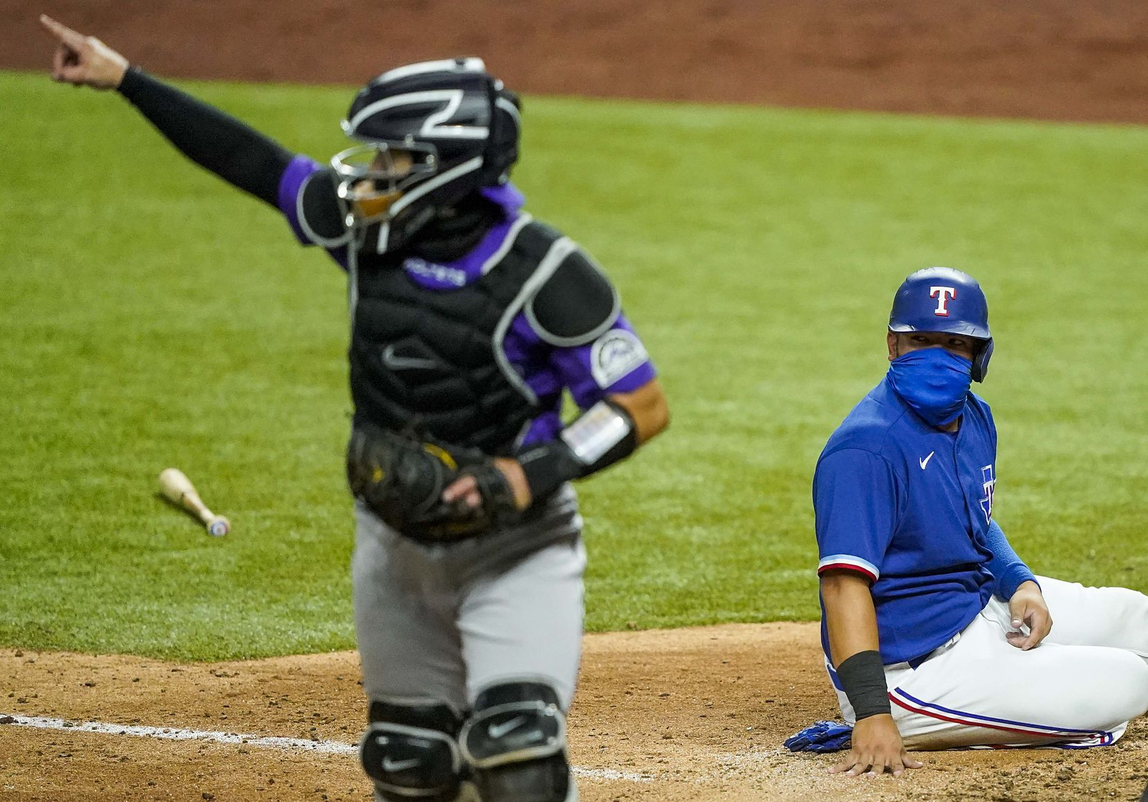 Texas Rangers catcher Jose Trevino reacts after being thrown out at home trying to score on a double by outfielder Nick Solak as Colorado Rockies catcher Tony Wolters celebrates the tag on a throw by center fielder David Dahl during the sixth inning of an exhibition game at Globe Life Field on Tuesday, July 21, 2020.